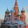 Vibrant colours and snow in sunshine of orthodox church Cathedral St. Vasily the Blessed (Saint Basil's) on Red Square in Moscow Russia