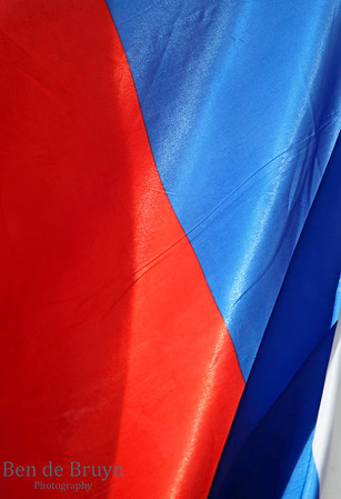 Russian flag of red blue and white blowing in the wind