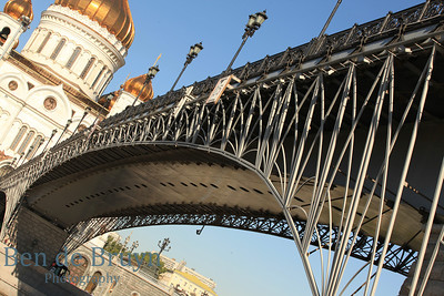 Sunshine and blue sky day and steel bridge at orthodox church Cathedral of Christ the Saviour in Moscow Russia