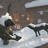 Bear and wolf character statutes of a Russian fable near the Alexander Gardens in Moscow Russia in winter