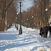 People walking in snow in park on cold Moscow winter day