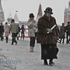 Woman walking through the Resurrection Gate Red Square Moscow Russia on very cold winter day