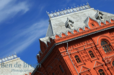 Red brick wall and silver roof of state historical museum in Moscow Russia on a sunny day