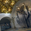 Aviamotornaya metro station Moscow Russia with anodized gold pyramids shaped objects as ceiling and sculpture against wall