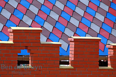 Red blue and grey tile roof and red brick wall at  Izmaylovo market in Moscow Russia