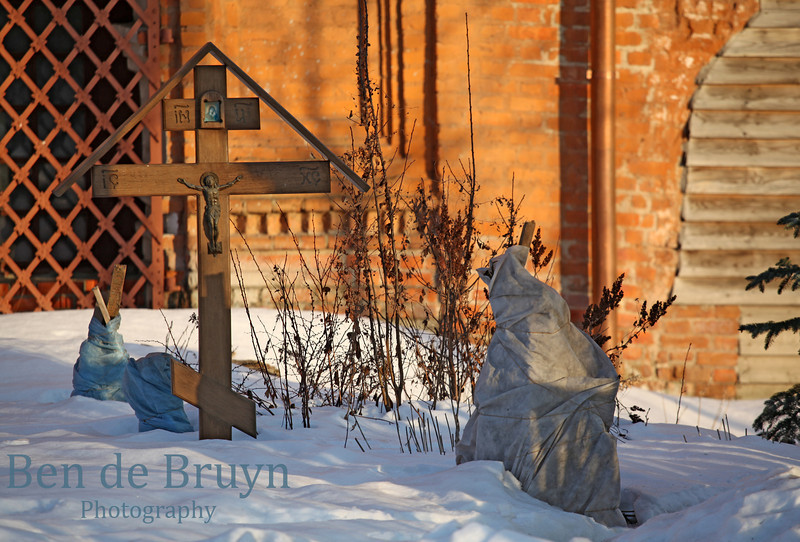 Bright sunshine and cross in snow at orthodox church and monastery of Our Lady of the Sign in Moscow Russia