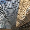 Glass window ceiling and blue sky seen from GUM department in Moscow Russia