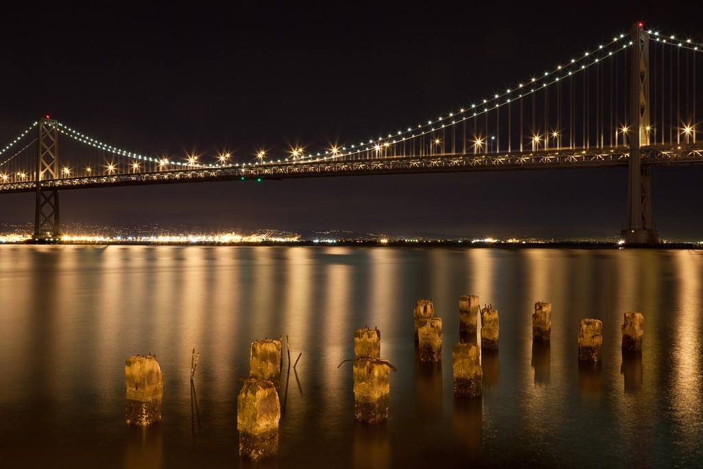 The San Francisco Bay Bridge with pilings in the foreground