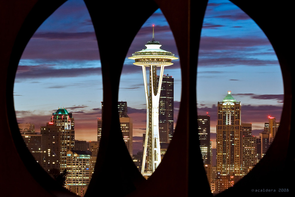 "Dawn in Seattle<br /> <br /> The Space Needle and the city of Seattle at dawn as seen from Kerry Park through the sculpture ""Changing Form"" by Doris Chase.<br /> <br /> I took this shot in November 2008, with my 1st ever DSLR, a Canon Rebel XT and using my 70-300 consumer quality zoom. I edited it using ACR (which I was also using for the 1st time ever).<br /> <br /> This shot was selected for the 1st ever Microsoft Employee Art Gallery, and for that ocasion I printed it 12x18 using my own HP B8850 (which is now defunct).<br /> <br /> This photo basically motivated me to keep going ..."