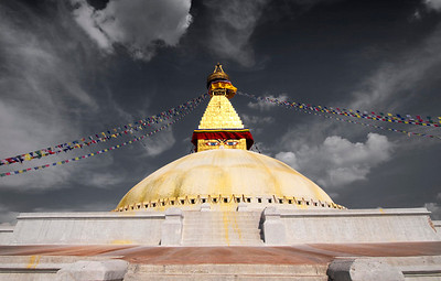 The Eyes See All, Kathmandu - Nepal  The great Buddhist temple of Bodhnath stands near the center of Kathmandu's old town. A UNESCO World Heritage site, Bodhnath was constructed between 400-500 AD, although the exact dates are lost to time. Above the large white dome is the four sided harmika, and each face has a painted pair of eyes looking in one of the four cardinal directions. The 13 tired spire at the top is plated with copper and represents the thirteen obstacles to enlightenment. Only after transcending these barriers can one reach the top to the parasol, or nirvana.