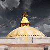 The Eyes See All, Kathmandu - Nepal<br /> <br /> The great Buddhist temple of Bodhnath stands near the center of Kathmandu's old town. A UNESCO World Heritage site, Bodhnath was constructed between 400-500 AD, although the exact dates are lost to time. Above the large white dome is the four sided harmika, and each face has a painted pair of eyes looking in one of the four cardinal directions. The 13 tired spire at the top is plated with copper and represents the thirteen obstacles to enlightenment. Only after transcending these barriers can one reach the top to the parasol, or nirvana.