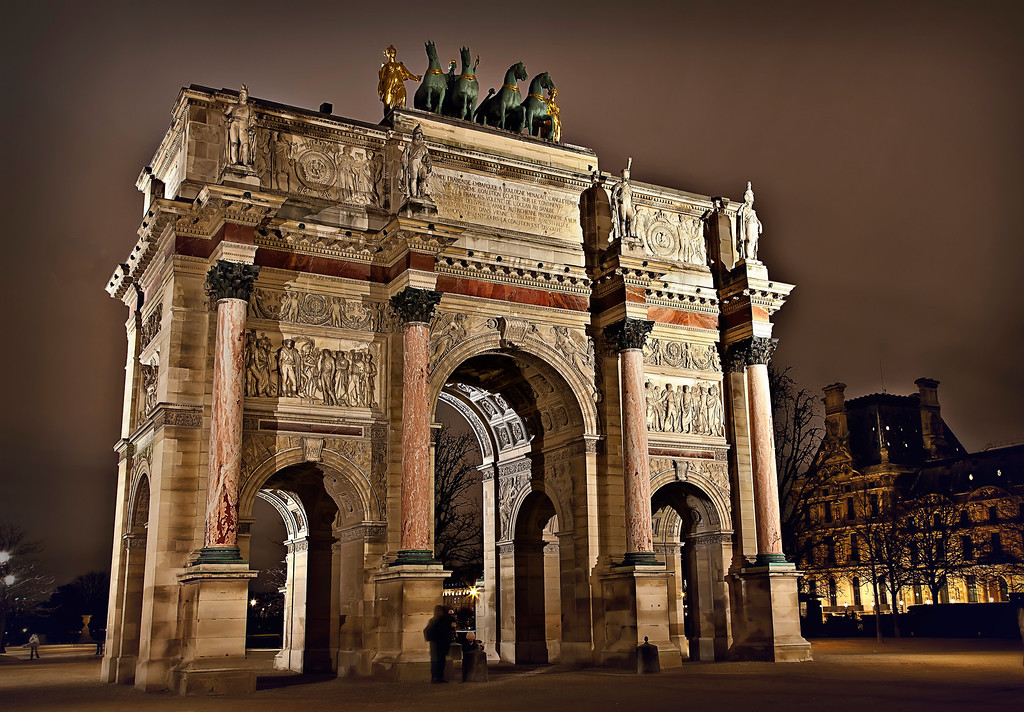 <h2>Arc de Triomphe du Carrousel</h2> This arch - the smallest of three commissioned by Napoleon, was built in 1806 to commemorate his Austrian victories and honor his grand army. Just a little something.  But the place itself goes way back. The arch sits on the field between the Louvre Palace and the Tuileries Garden. Back in the 1600's,  knights costumed in full regalia performed feats of horsemanship here, accompanied by music and song. Hence this spot's name: The Carrousel.   Now when you visit - you'll know a little history.    ©Karen Hutton - Creative Commons (CC BY-NC 3.0)