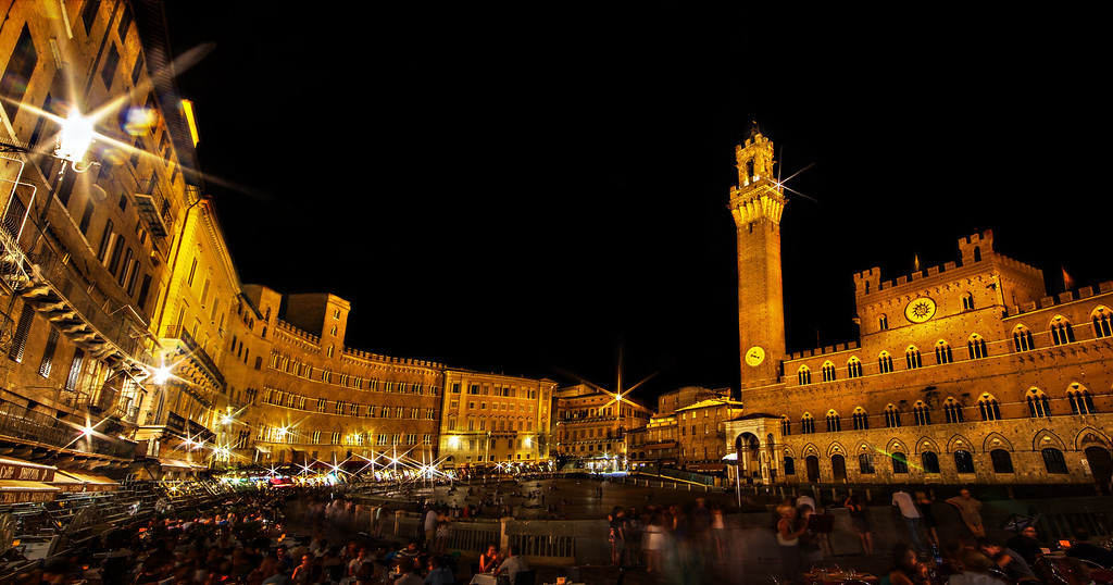 "<h2>Il Piazza del Campo di Notte</h2> The Pizza del Campo in Siena is breathtaking by day, but at night... swoonworthy!  The second of the two Palio races was to be run the following week, so we missed it... but standing there fulfilled a dream I've had since I was a child and read (lived!) a book called: ""Gaudenzia, Pride of the Palio"", by Marguerite Henry. It was awesome.   ©Karen Hutton - Creative Commons (CC BY-NC 3.0)"