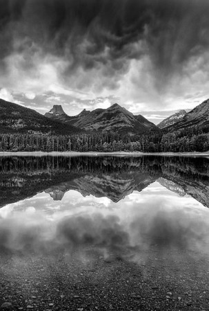 Wedge Pond at Kananaskis Country in the Majestic Canadian Rockies.   No trick photography  just a beautiful reflection before a huge storm ended my day of photography.
