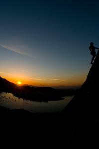 Rock climbing above the city of Rio de janeiro at sunset, Via de Italianos, 5.10, on the Pan Azucar, Rio de Janeiro, Brasil..