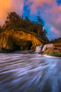 """FORCES OF NATURE""Northern Oregon CoastThe setting sun reflected onto a unique location on Oregon's northern coast, where a waterfall flows off a small cliff into the incoming tides of the Pacific Ocean.© Chris Moore - Exploring Light PhotographyPURCHASE A PRINT"