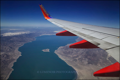 View of the wing of Southwest Airline aircraft above the Pyramid Lake, Nevada.