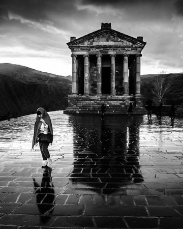 A girl visits one of the oldest holy sites in the world, the Temple at Garni. This temple was first constructed in the 3rd century BC ot 77 AD depending on your source.