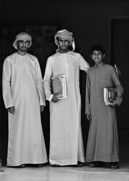 Three school boys. The recently rich country of the UAE is speding billions overhauling its education system. It is proving very difficult. Abu Dhabi, UAE.