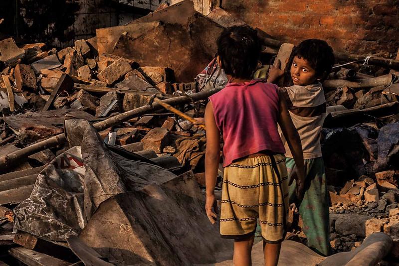 Children playing builders in Delhi Delhi, India