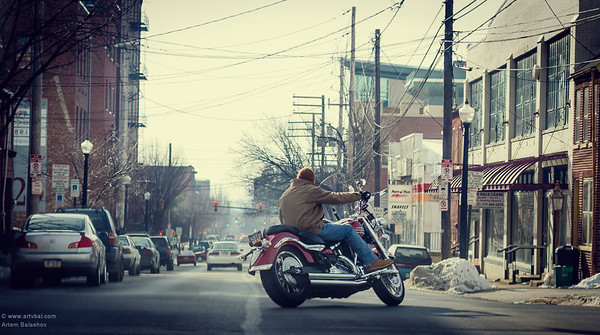 A motorcycle rider on route 272, central area of Lancaster, PA, USA, February 2014