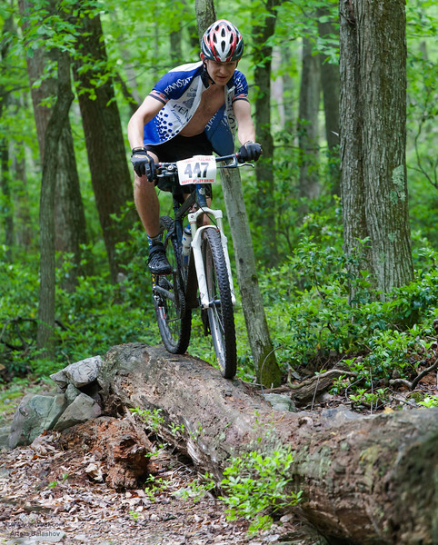 """""""Showing OFF"""" - Racer rides on the wet log, HVB June 2013 Mountain Bike Race, Rorthrock State Forest, PA, USA"""