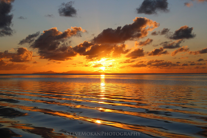 Smooth as glass- one of the most amazing sunsets I've ever seen, in French Polynesia