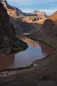 Sunrise above river camp, Grand Canyon, Arizona.