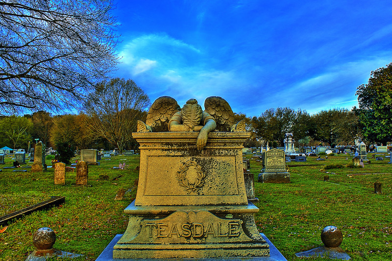 Teasdale Monument. Weeping with Love from above. A Broken Heart in the clouds during sunrise above the Weeping Angel Friendship Cemetery Columbus Mississippi .Canon HDR. No I repeat no Photoshop.