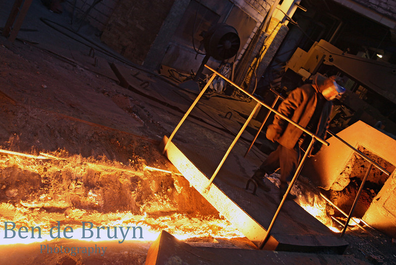 Man at work at a factory producing pig iron