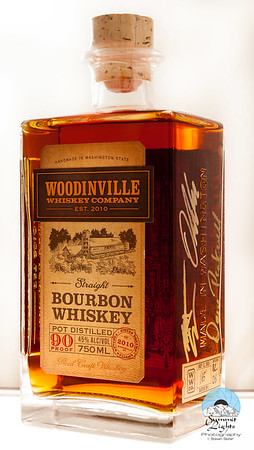 Woodinville Whiskey Co. 5 Year Flagship Straight Bourbon Whiskey, numbered 165, signed by Co-founders and Distillers Orlin Sorensen and Brett Carlile along with Dave Pickerell, former Master Distiller at Maker's Mark