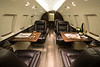 """The interior of the Hawker. Most interior shots consist of a """"forward"""" shot towards the cockpit and a rearward shot towards the galley or lavatory. This way the viewer can really get a feel for the complete interior of the aircraft and whether it would be a fit for their needs.<br /> <br /> For these shots, utilizing ultrawide angle lenses gives the cabin a big, roomy, inviting look."""