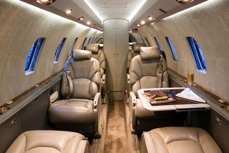 Interior of a Citation. Having only one table out provides an asymmetrical look that enhances what is on the other table. Sometimes having all of the tables out can create a claustrophobic look inside of the smaller cabins, and we aim to make the cabin look as spacious as possible. Frames with tables on right, left, and both sides deployed are taken and the customer chooses which one they prefer.