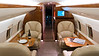 Interior of a Challenger. The large interior of a Challenger is perfect for group travel, and it also has a complete galley. Emphasizing this with dinnerware and showing the galley itself helps remind the customer what this level of aircraft provides.<br /> <br /> I bring my own equipment and supplement any necessary decorations with props I supply such as magazines, glassware, drinks, food, flowers, tablecloths, et cetera. If you have anything specific you want included in an interior, no problem - just bring it along on shoot day.