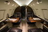 """The interior of the Hawker. Most customers need, at a minimum, two interior shots consisting of a """"forward"""" shot towards the cockpit and a rearward shot towards the galley or lavatory. This way the viewer can really get a feel for the complete interior of the aircraft.<br /> <br /> Although the screens are currently off in this photo, it is possible to post-process and introduce company logos or other still images on to in-flight entertainment screens."""