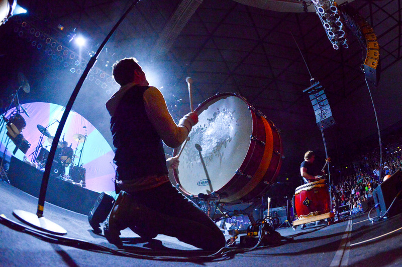 Dan Reynolds beats the drum in dramatic fashion at the Imagine Dragons concert. In Ogden, on October 23 2013.