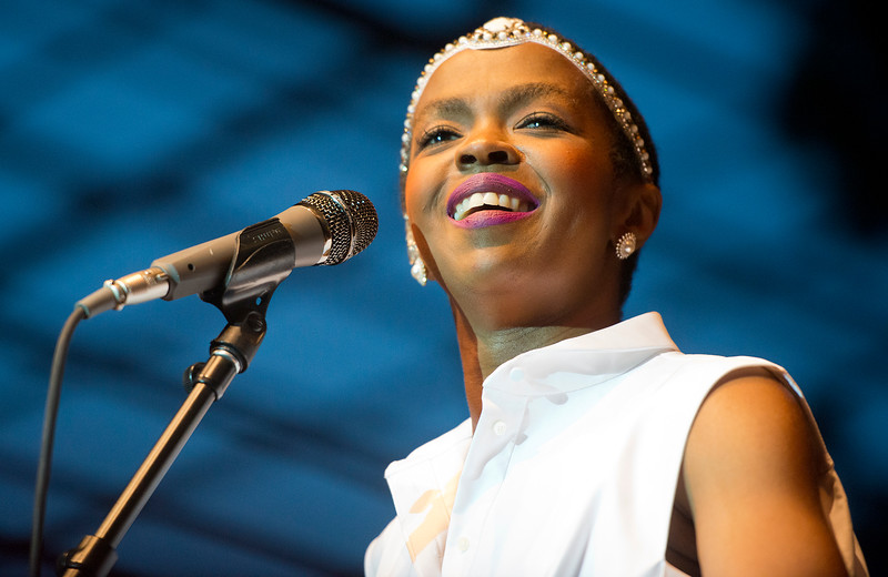 Lauryn Hill talks to the audience between songs. During The Twighlight Concert series . In Salt Lake City . On July 10, 2014.