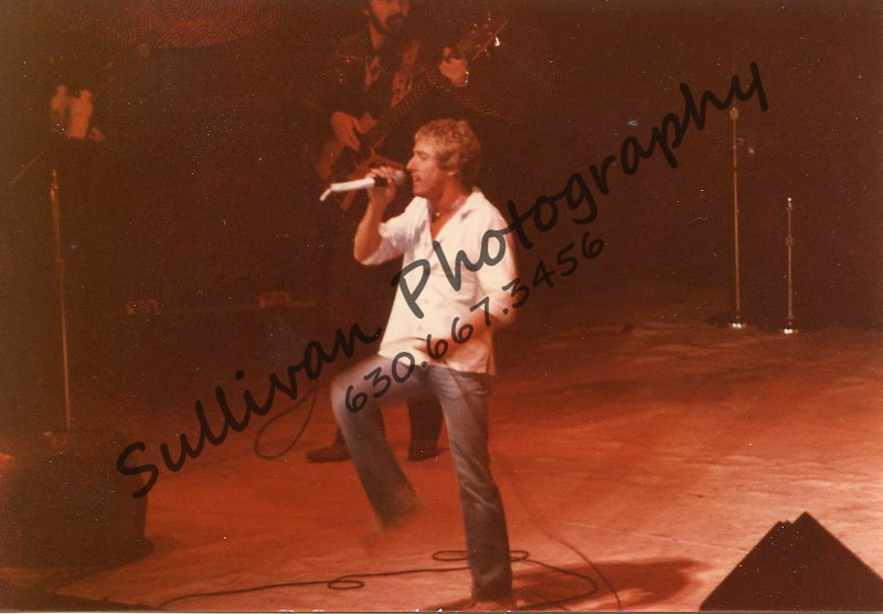 Roger Daltry of The Who. This was the first tour after Keith Moon's death. Kenny Jones was the drummer.<br /> This was at the International Amphitheater. I was half way back, in the upper deck, with my camera long lens and a tripod! Can't get in with that kind of hardware now.