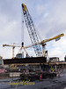 A crane lifts a large steel tub girder off a truck and into place on the Nova Centre construction site on November 3, 2014.