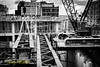 A crane lowers a large steel tub girder into place on the Nova Centre construction site on November 3, 2014.