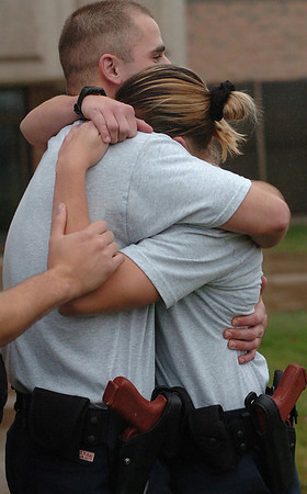 "Angel embraces cadet Matthew Vanderploeg after enduring 50,000 volts of electricity for 5 seconds during tazer training.  For the first and only time in Angel's police academy training, she broke down and lost control.  ""We understood each other. I knew he'd be there when I needed him,"" she said."