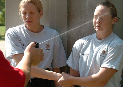 Cadet Angel Merren gets maced in the face as her partner Cadet Tracie Noe helps her.  The Cadets must learn to work through the effects so they'll be prepared for a real-life situation.