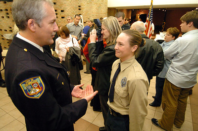 Cadet Merren talks to KDPS police chief Dan Weston about a future job after graduation ceremonies at KVCC on December 7.