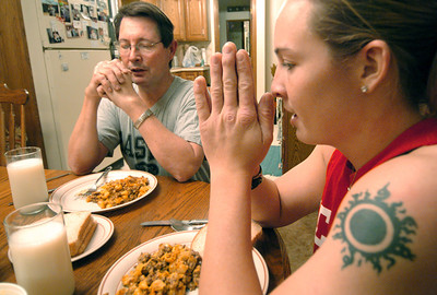 "Angel says a prayer with her father Jim Merren at her Wayland home before eating a power meal consisting of venison, cheese, white bread and milk.  ""I definitely grew closer to my dad throughout the Academy,"" she said."