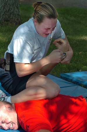 Cadet Merren subdues officer Chuck Pelfrey while fighting through the effects of pepper spray.