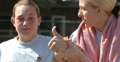 Cadet Angel Merren gives a confident thumbs up as her partner Tracie Noe helps her work through the effects of pepper spray.