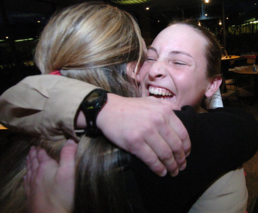 Angel hugs her MSU assistant softball coach, Amanda Scott, after the graduation ceremony at KVCC on December 9, 2004.