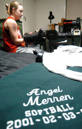 Angel Merren shines her boots at her home in her bedroom in Wayland as part of her nightly routine after a long day of classes and physical training.  Before entering the Academy, Angel attended MSU on a full ride softball scholarship.