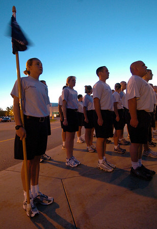 Cadet Merren holds the class flag during morning formation.     Merren was chosen to be the guide-on bearer, carrying the flag and representing the class.