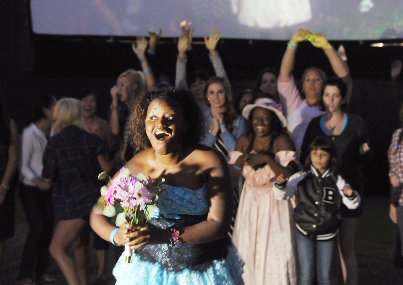 Kirstie Colin wins the pre-show bridemaid dress contest at  the 2012 Street Food Cinema featuring a screening of Bridesmaids on Saturday, August 4, 2012 in Los Angeles. (Photo by Katy Winn for Street Food Cinema/Invision/AP)